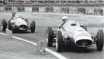 SIR STIRLING MOSS BACK IN THE HOT SEAT