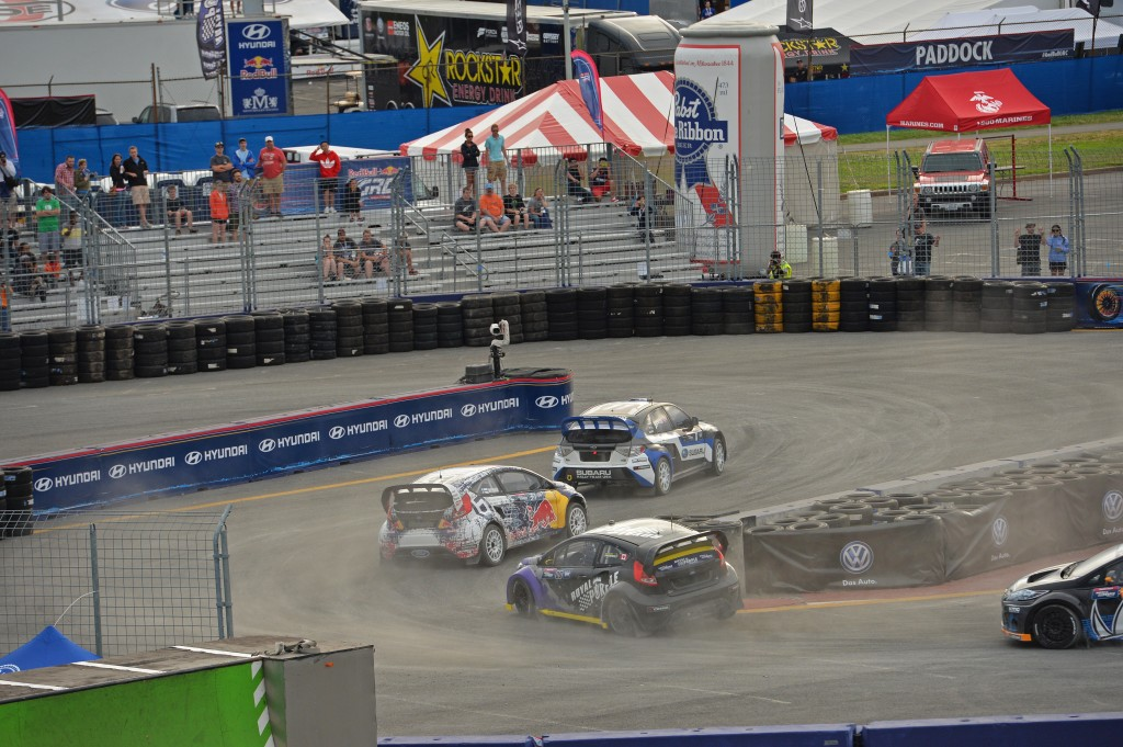 Sverre Isachsen leads a pack of GRC cars through a hairpin at Red Bull Global Rallycross in Washington D.C.