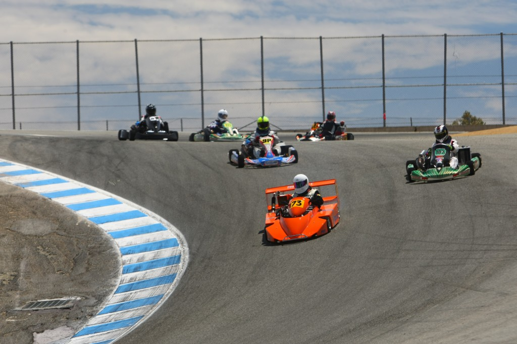 Karts attacking the corkscrew on lap 1